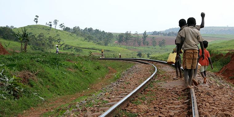 Children walk along a railway